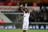 Ashley Williams, the Swansea city captain celebrates his teams win at the end of the match. Barclays Premier league match, Swansea city v West Bromwich Albion at the Liberty Stadium in Swansea, South Wales  on Boxing Day Saturday 26th December 2015.<br /> pic by  Andrew Orchard, Andrew Orchard sports photography.