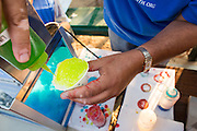 Members of the Cathedral of Faith Milpitas make snow cones for children during National Night Out at Selwyn Park in Milpitas, California, on August 7, 2014. (Stan Olszewski/SOSKIphoto)