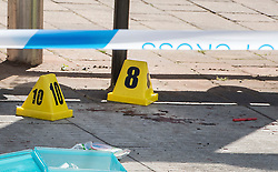 © Licensed to London News Pictures.  25/06/2018; Bristol, UK. Blood on the floor and evidence markers at a bus shelter near the scene of murder. A murder investigation has been launched after man dies and two are seriously injured in an armed burglary in Prewett Street, Redcliffe, in the early hours of the morning. It is reported that neighbours have told of hearing bloodcurdling screams of as three men were attacked with a sword-like knife. Two other men who suffered life-threatening injuries have been taken to hospital. It is reported that two men from London have been arrested in connection with the incident. Photo credit: Simon Chapman/LNP