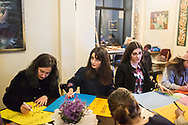 Mizgin Kizil, 22 (centre) with fellow members of the Kampüs Cadıları (Campus witches) make placards for the upcoming international women's day on March 8th 2018, at a cafe in Kadıköy district of Istanbul, Turkey.