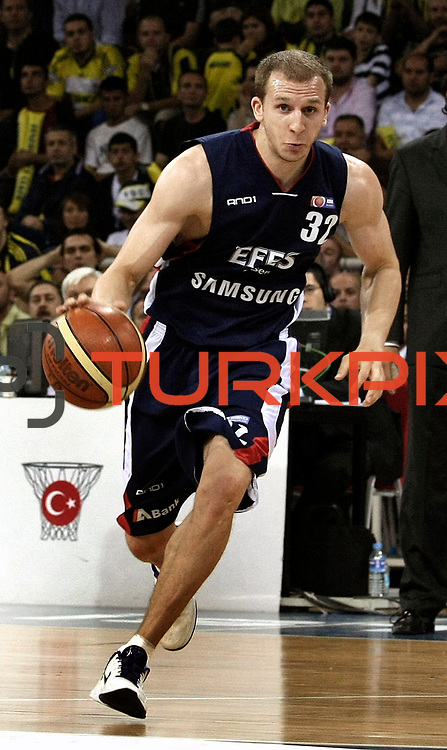 Efes Pilsen's Sinan GULER during their Turkish Basketball league Play Off Final fourth leg match Fenerbahce Ulker between Efes Pilsen at the Abdi Ipekci Arena in Istanbul Turkey on Thursday 27 May 2010. Photo by Aykut AKICI/TURKPIX