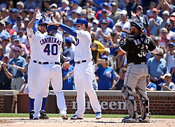 July 25, 2017 - Chicago, IL, USA - Chicago Cubs catcher Willson Contreras (40) celebrates his three-run home run with Ben Zobrist and Anthony Rizzo as Chicago White Sox catcher Omar Narvaez (38) waits in the first inning on Tuesday, July 25, 2017, at Wrigley Field in Chicago. The Cubs won, 7-2. (Credit Image: © Brian Cassella/TNS via ZUMA Wire)