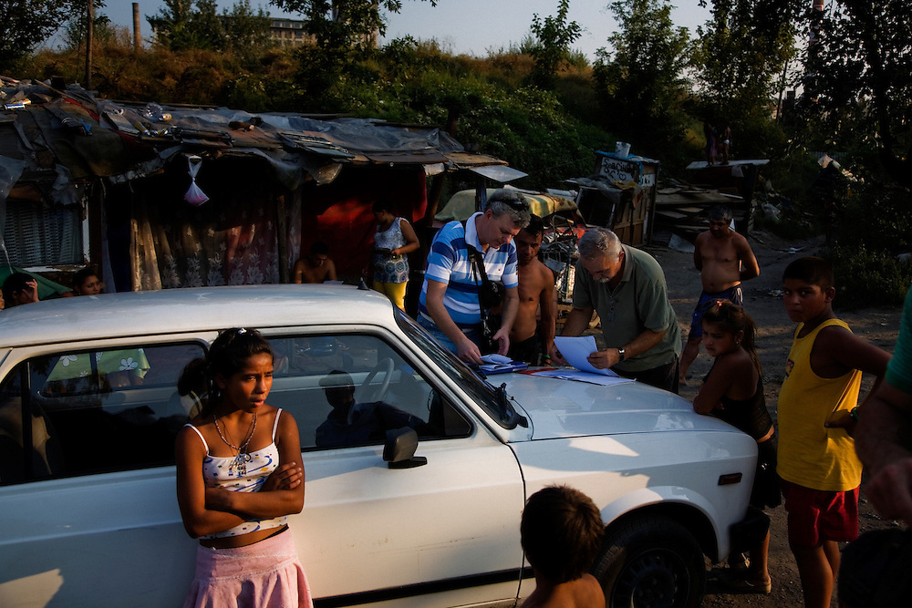 City officials arrive in the Stara Gazela camp to make final inquiries into the status of families and have them sign legal documents pertaining to the relocation.