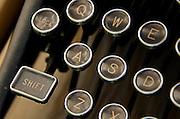 Closeup of antique typewriter keys, including the shift key.
