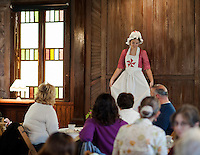 Bridget Eldridge dressed in a traditional young ladies fashion from the 1800's during Thompson Ames Historical Society's fashion show and luncheon Saturday afternoon at the Union Meetinghouse in Gilford.   (Karen Bobotas/for the Laconia Daily Sun)