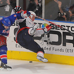 May 12, 2012: New York Rangers defenseman Michael Del Zotto (4) checks Washington Capitals left wing Jason Chimera (25) to the ice during third period action in game 7 of the NHL Eastern Conference Semi-finals between the Washington Capitals and New York Rangers at Madison Square Garden in New York, N.Y. The Rangers defeated the Capitals 2-1.