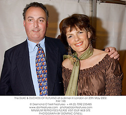 The DUKE & DUCHESS OF RUTLAND at a dinner in London on 20th May 2002.		<br />