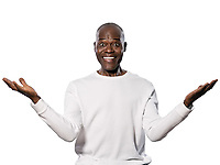 Portrait of an excited afro American man with eyes wide open smiling in studio on white isolated background