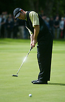 Photograph: Scott Heavey<br />Volvo PGA Championship At Wentworth Club. 25/05/2003.<br />Trevor Immelman holds a steady putt at the 4th.
