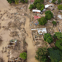Views of the damage done by hurricanes Eta and Iota in Chamelecón, San Pedro Sula, Honduras. Many houses were washed away, leaving rubble or nothing, and many were badly damaged. As the flooding came unexpectedly fast many people lost all their belongings including their furniture.