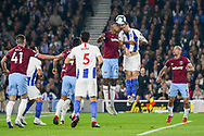 West Ham United defender Issa Diop (23) and Brighton and Hove Albion defender Shane Duffy (4) battle in the air during the Premier League match between Brighton and Hove Albion and West Ham United at the American Express Community Stadium, Brighton and Hove, England on 5 October 2018.