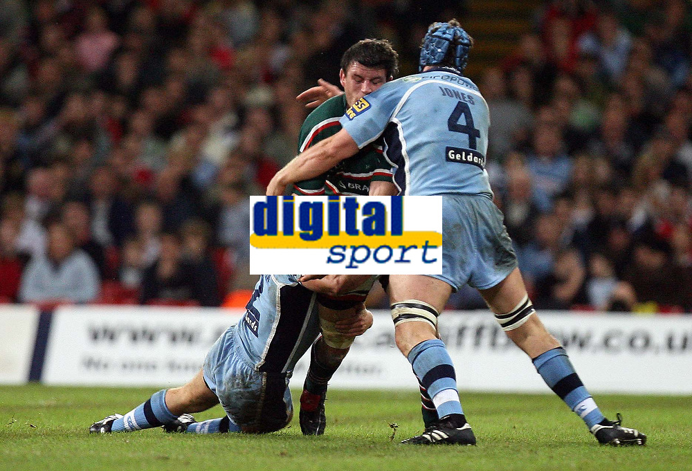 Photo: Rich Eaton.<br /> <br /> Cardiff Blues v Leicester Tigers. Heineken Cup. 29/10/2006. Martin Corry of Leicester Tigers is tackled by Deiniol Jones of Cardiff Blues #4