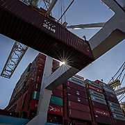 Jockey trucks and ship to shore cranes work the Maersk container ship Gustav Maersk the Georgia Ports Authority's Port of Savannah Garden City Terminal, Saturday, Sept., 21, 2019, in Savannah, Ga.  (GPA Photo/Stephen B. Morton)