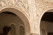 The Alhambra Palace and fortress complex located in Granada, Andalucia, Spain. Moorish designs and architecture details in the beautiful Court of Water Channel (Patio de la Acequia) in the Generalife area. This area was built for the Granadian monarchs to escape their official routine.