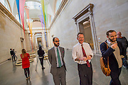 Tate Director Nicholas Serota shares a laugh with some guests - the filters by Christina Mackie - a three-part installation for the annual Tate Britain Commission. This invites artists to make new work in response to the grand spaces of the Duveen Galleries. These have been transformed by a composition of 12-metre-high dipped silk nets suspended over pans of semi-crystallised dye, anchored to the floor by hand cast weights. Alongside this aerial network of ropes and colourful dyed silk is a vibrant yellow sculpture and a plinth displaying chunks of raw glass.
