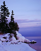 Dusk descendibng over calm winter waters of Lake Superior, Cascade River State Park, Minnesota.