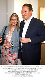 The HON.THOMAS NOEL and MISS OLIVIA BUCHANAN-JARDINE a friend of Prince William, at a party in London on 7th May 2003.PJJ 201