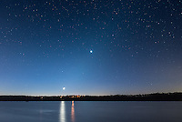 The twilight sky was beautiful early this morning. A very thin crescent moon was rising over Spring Lake. In the middle is the bright planet Venus. The faint zodiacal light can be seen extending diagonally between the two.