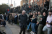 Crowds gather to listen to a busker playing on Regents Canal during the second coronavirus national lockdown on November 7th 2020 Hackney, East London, United Kingdom. In-spite of current social distance rules many people stopped to enjoy the music, spreading out along the canal. The UK Government introduced a 4 week lockdown from November 5th - December 2nd to combat the coronavirus outbreak. It is the third day of the national lockdown and restrictions mean that people are only allowed to meet outside, in pairs and only if keeping social distance. Only if they already live together or have formed a social bubble can they interact freely.