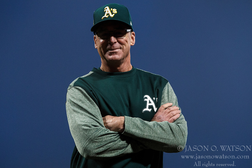 SAN FRANCISCO, CA - JULY 13: Bob Melvin #6 of the Oakland Athletics stands outside the dugout during the fifth inning against the San Francisco Giants at AT&T Park on July 13, 2018 in San Francisco, California. The San Francisco Giants defeated the Oakland Athletics 7-1. (Photo by Jason O. Watson/Getty Images) *** Local Caption *** Bob Melvin