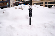 08 FEBRUARY 2021 - DES MOINES, IOWA: A parking meter buried in snow in downtown Des Moines. Central Iowa, including Des Moines, is enduring its coldest winter in 25 years. Daily high temperatures this week are not expected to go above 10F (-12C) and nightly lows are expected to be about -5F (-20C). In addition to the cold weather, this is the second snowiest winter in Des Moines history. So far this winter there has been more than 44 inches (111 centimeters) of snow. Des Moines normally gets about 35 inches (90 centimeters) of snow all winter.        PHOTO BY JACK KURTZ