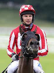 Love Island's Chris Hughes rides Carnageo during The Best Western Hotels & Macmillan Ride of their Lives, during the Macmillan Charity Raceday at York Racecourse.