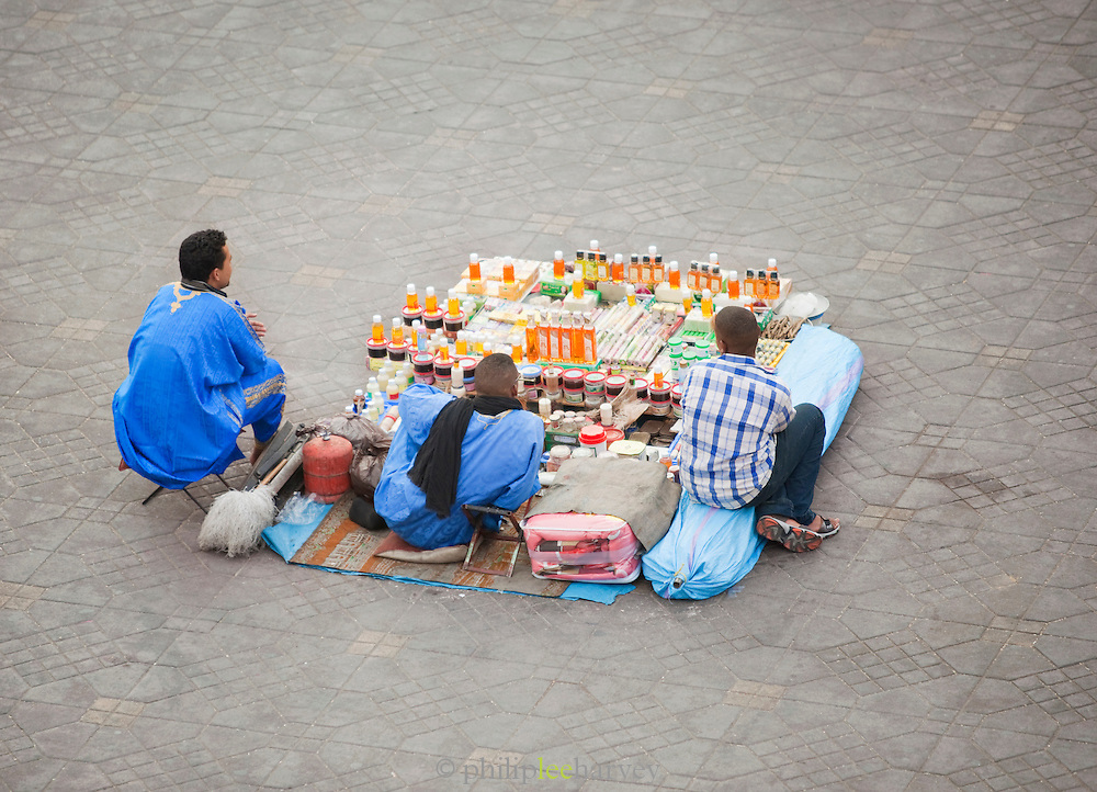 Men selling cosmetics at a stall in the Djemaa el Fna in the medina of Marrakech, Morocco
