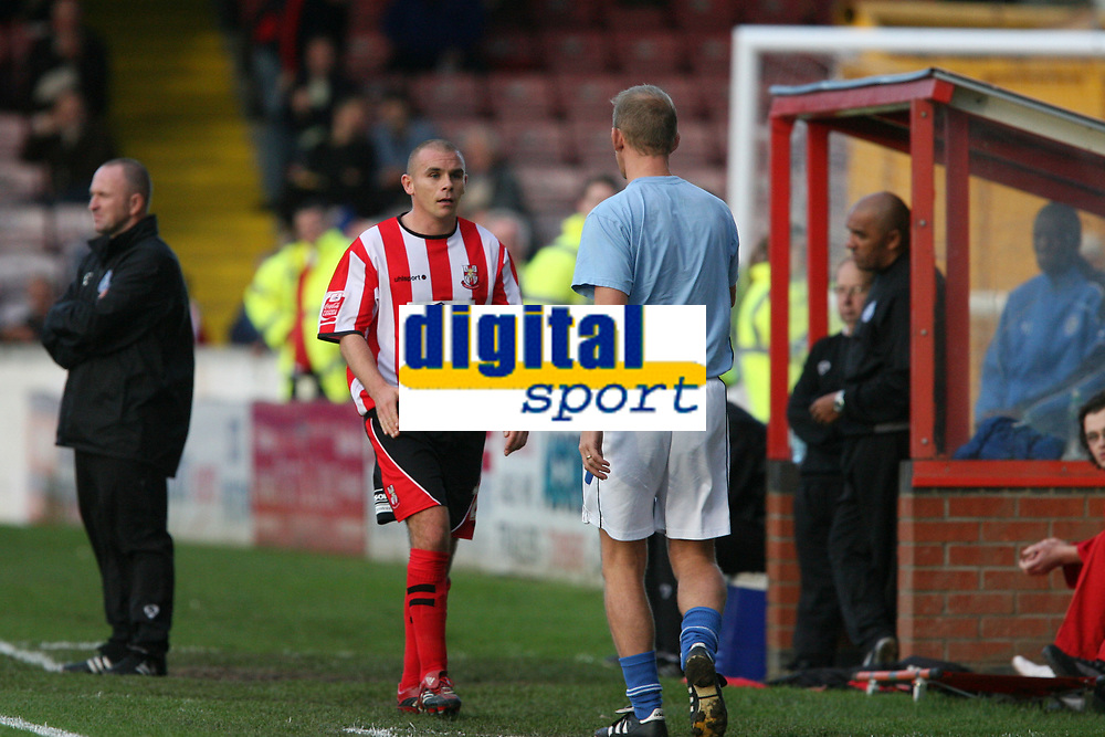 Photo: Pete Lorence.<br />Lincoln City v Rochdale United. Coca Cola League 2. 21/10/2006.<br />Jamie Forrester and Linconl City manager, John Schofield, shake hands as the day's top goalscorer leaves the pitch.