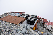 """Kita-hotaka Mountain Hut perches near the summit of Mount Kitahotaka, which reaches 3106 m elevation (10,190 ft, Japan's 9th highest) in Chubu-Sangaku National Park, Japan. This is the highest hut in Japan, excluding those on Mt Fuji. I hiked Kitahotaka (or Kitahotaka-dake) 4km round trip from Karasawa Goya hut via a steep trail secured with chains & ladders ascending 800 meters. Mt Kitahotaka is the second highest peak on Mount Hotaka (Hotaka-dake or the Hotaka Mountains), which are in the """"Northern Japan Alps"""" (Hida Mountains). North of Kitahotaka-dake lies an exposed 3.5+ hour scramble via Daikiretto Gap helped by chains and ladders, connecting with Minamidake Mountain Hut. I avoided the Daikiretto by returning to Karasawa cirque, then walking all the way back to a comfortable dorm slot reserved at Tokusawa-en backcountry lodge (16 km, 800 meters up, 1615 m down)."""
