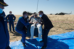 Expedition 62 crew member Andrew Morgan of NASA is carried to an All Terrain Vehicle (ATV) shortly after he, NASA astronaut Jessica Meir, and Roscosmos cosmonaut Oleg Skripochka landed in their Soyuz MS-15 spacecraft near the town of Zhezkazgan, Kazakhstan on Friday, April 17, 2020. Meir and Skripochka returned after 205 days in space, and Morgan after 272 days in space. All three served as Expedition 60-61-62 crew members onboard the International Space Station.<br /> <br /> Where: Zhezkazgan, Kazakhstan<br /> When: 17 Apr 2020<br /> Credit: NASA/GCTC/Andrey Shelepin/Cover Images<br /> <br /> **Editorial use only**