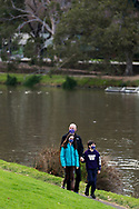 A family wearing facemasks are seen walking along the Yarra during COVID-19 in Melbourne, Australia. Hotel quarantine linked to 99% of Victoria's COVID-19 cases, inquiry told. This comes amid a further 222 new cases being discovered along with 17 deaths. Melbourne continues to reel under Stage 4 restrictions with speculation that it will be extended. (Photo by Dave Hewison/Speed Media)