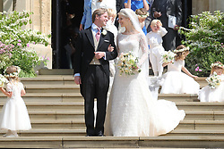 Newlyweds Thomas Kingston and Lady Gabriella Windsor smile on the steps of the chapel with their bridesmaids, page boys and guests after their wedding at St George's Chapel in Windsor Castle.