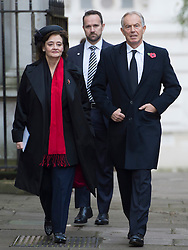 Former Prime Minister Tony Blair and Cherie Blair walk through Downing Street on their way to the annual Remembrance Sunday Service at the Cenotaph memorial in Whitehall, central London, held in tribute for members of the armed forces who have died in major conflicts.