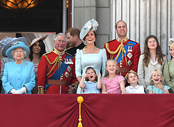 (left to right) Queen Elizabeth II, Duchess of Sussex, Prince of Wales, Duke of Sussex and the Duke and Duchess of Cambridge with Princess Charlotte, Savannah Phillips and Prince George, on the balcony of Buckingham Palace at Trooping The Colour, London. Photo credit should read: Doug Peters/EMPICS