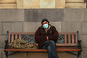 "A homeless man, wearing face protective surgical mask, appears to be sit-sleeping outside Armenian Government premises in the Republic Square, Armenian capital Yerevan on Sunday, Dec 13, 2020. Armenian officials and Azerbaijan on Saturday accused each other of breaching a peace deal that ended six weeks of fierce fighting over Nagorno-Karabakh, with Azerbaijan's leader threatening to crush Armenian forces with an ""iron fist"".<br /> Russian peacekeepers deployed to the region to monitor the peace deal reported a violation of the ceasefire in the Gadrut region on Friday. The report issued on Saturday by the Russian defence ministry did not assign blame. (VXP Photo/ Vudi Xhymshiti)"