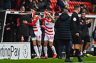 Ben Whiteman of Doncaster Rovers (8) scores a goal and celebrates with the bench and staff to make the score 1-0 during the EFL Sky Bet League 1 match between Doncaster Rovers and Scunthorpe United at the Keepmoat Stadium, Doncaster, England on 15 December 2018.
