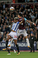Jose Fonte of West Ham Utd ® and Steve Mounie of Huddersfield Town battle for the ball . Premier league match, West Ham Utd v Huddersfield Town at the London Stadium, Queen Elizabeth Olympic Park in London on Monday 11th September 2017.<br /> pic by Kieran Clarke, Andrew Orchard sports photography.