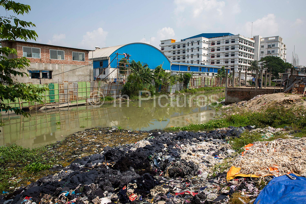 Environmental pollution on the river banks surrounding some of the textile industry buildings of Savar Upazila on 30th September 2018 in Dhaka, Bangladesh. The garment business is the main industry of Savar Upazila, a district in the northern part of Dhaka.