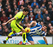 Huddersfield Town defender Mark Hudson & Brighton striker Tomer Hemed battle for possession during the Sky Bet Championship match between Brighton and Hove Albion and Huddersfield Town at the American Express Community Stadium, Brighton and Hove, England on 23 January 2016. Photo by Bennett Dean.