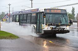 A transit bus passes through standing water street in Moncton, N.B. as a result of hurricane Dorian pounding the Atlantic Provinces with heavy rain and winds on Saturday September 7, 2019, Canada. Photo by Marc Grandmaison/CP/ABACAPRESS.COM