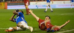 Rangers Alfredo Morelos and Aberdeen's Scott McKenna battle for the ball during the Ladbrokes Scottish Premiership match at Pittodrie Stadium, Aberdeen