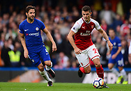 Granit Xhaka of Arsenal breaks away from Cesc Fabregas of Chelsea. Premier league match, Chelsea v Arsenal at Stamford Bridge in London on Sunday 17th September 2017.<br /> pic by Andrew Orchard sports photography.