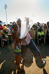 03 May 2015. New Orleans, Louisiana.<br /> The New Orleans Jazz and Heritage Festival. <br /> Glenn Bozant asks Kim Rose to marry him at the Congo Square stage. Kim said yes. <br /> Photo; Charlie Varley/varleypix.com