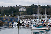 Small boats and yachts in the harbour marina in on 25th September 2021 in Audierne, Brittany, France. Audierne is a commune in the Finistère department of Brittany. On 1 January 2016 the former commune of Esquibien merged into Audierne. The town lies on a peninsula at the mouth of the Goyen river and for centuries was a fishing village. The harbour, formerly important to the local fishing industry, is now essentially a yacht port. Brittany is a peninsula, historical county, and cultural area in the west of France, covering the western part of what was known as Armorica during the period of Roman occupation. It became an independent kingdom and then a duchy before being united with the Kingdom of France in 1532 as a province governed as a separate nation under the crown.