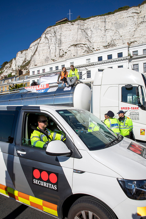Two activist from Insulate Britain have glued themselves to the top of a lorry at the entrance to the port of Dover on the 24th of September 2021. Over 40 activists from Insulate Britain blocked the road with some gluing themselves to the carriageway of the A20 at the Eastern docks roundabout. There are blocking the roads to highlight that fuel poverty is killing people in Dover and across the UK. (photo by Andrew Aitchison / In pictures via Getty Images)
