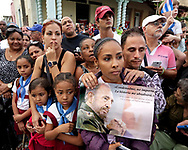 Cubans wait for the passage of Fidel Castro's ashes in Santa Clara, Cuba on Thursday, December 1, 2016.