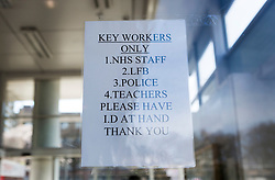 © Licensed to London News Pictures. 22/03/2020. London, UK. A sign at a Tesco store in Hackney, east London shows which key workers will be let in to the shop for one hour.  The shop opened between 10-11am just for key workers with other shoppers let in in small groups after that time.  Photo credit: Marcin Nowak/LNP