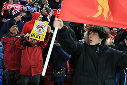 11th February 2017 - Premier League - Liverpool v Tottenham Hotspur - A young Liverpool fan displays a flyer saying The Sun newspaper is not welcome - Photo: Simon Stacpoole / Offside.