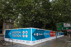 London, UK. 5th August, 2021. A hoarding is pictured around works for the HS2 high-speed rail link in Euston Square Gardens. A new temporary taxi rank is being constructed for Euston station following the removal of a 30m network of tunnels dug by HS2 Rebellion activists seeking to delay or prevent the felling of trees on the site.