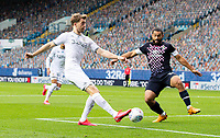 Leeds United's Patrick Bamford shoots under pressure from Luton Town's Cameron Carter-Vickers<br /> <br /> Photographer Alex Dodd/CameraSport<br /> <br /> The EFL Sky Bet Championship - Leeds United v Luton Town - Tuesday 30th June 2020 - Elland Road - Leeds<br /> <br /> World Copyright © 2020 CameraSport. All rights reserved. 43 Linden Ave. Countesthorpe. Leicester. England. LE8 5PG - Tel: +44 (0) 116 277 4147 - admin@camerasport.com - www.camerasport.com